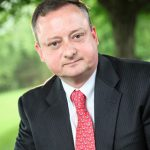 Dr. Kieran Ayre – Executive Director